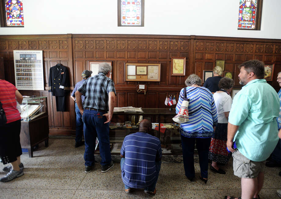 People look through artifacts and equipment from past conflicts at the Temple to the Brave on Monday. The Temple to the Brave in Pipkin Patriots Park opened Monday afternoon in honor of Memorial Day. Photo taken Monday 5/25/15 Jake Daniels/The Enterprise Photo: Jake Daniels / ©2015 The Beaumont Enterprise/Jake Daniels