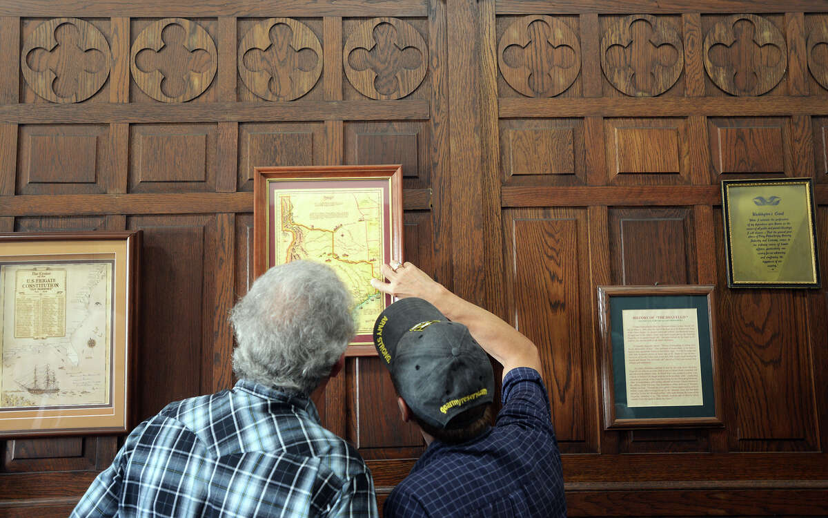 Two men look over a map on display at the Temple to the Brave on Monday. The Temple to the Brave in Pipkin Patriots Park opened Monday afternoon in honor of Memorial Day. Photo taken Monday 5/25/15 Jake Daniels/The Enterprise