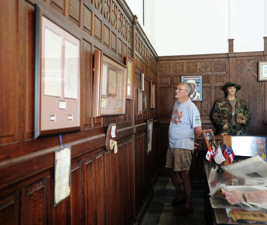 Allan Nichols peruses some of the documents on display at the Temple to the Brave on Monday. The Temple to the Brave in Pipkin Patriots Park opened Monday afternoon in honor of Memorial Day. Photo taken Monday 5/25/15 Jake Daniels/The Enterprise Photo: Jake Daniels / ©2015 The Beaumont Enterprise/Jake Daniels