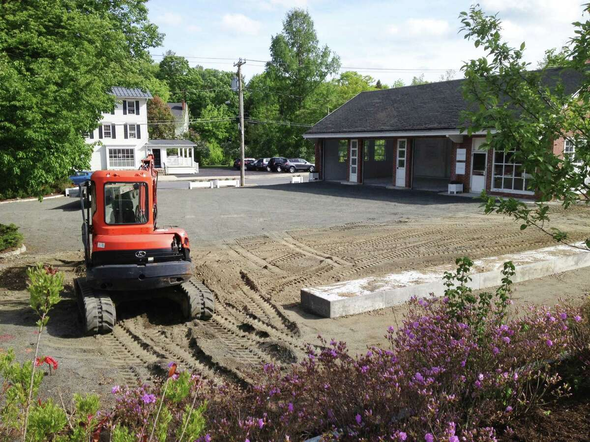 A landscaped park called The Park@ One Green Hill is planned for the long vacant site of a former Texaco gas station in the heart of Washington Depot. May 2015