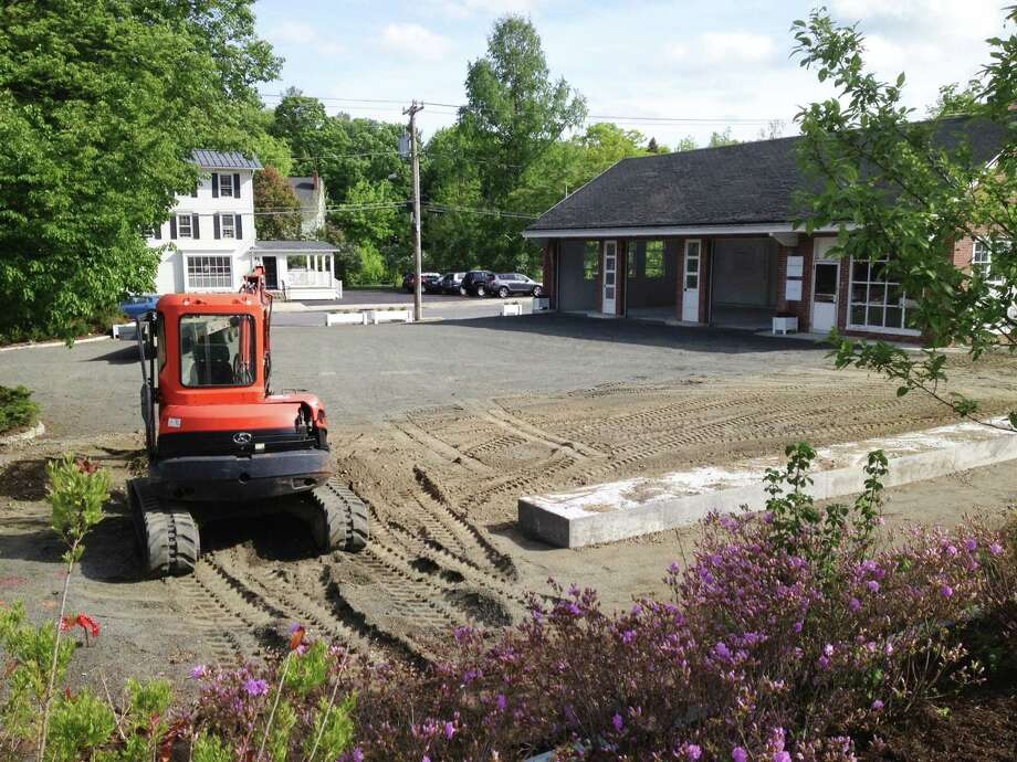 A landscaped park called The Park@ One Green Hill is planned for the long vacant site of a former Texaco gas station in the heart of Washington Depot. May 2015 Photo: Norm Cummings / The News-Times