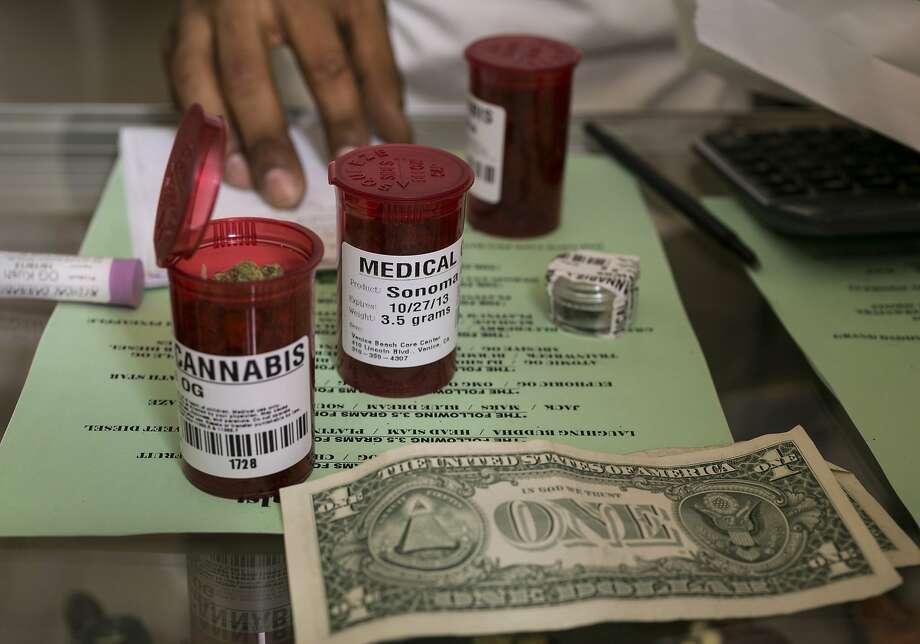 In this May 2013 file photo, medical marijuana prescription vials are filled at a medical marijuana dispensary in Venice, Calif. Photo: Damian Dovarganes, Associated Press