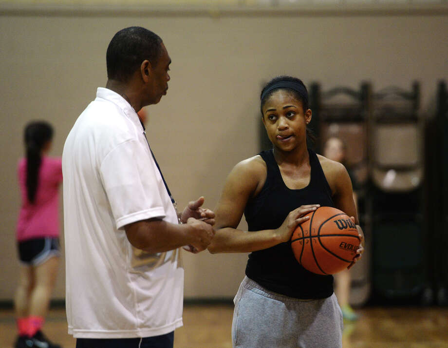 Legacy Christian Coach Jack Gilford talks with Alexis Morris during practice Wednesday afternoon. The Legacy Christian High School basketball team practiced Wednesday afternoon. Photo taken Wednesday 1/21/15 Jake Daniels/The Enterprise Photo: Jake Daniels / ©2014 The Beaumont Enterprise/Jake Daniels