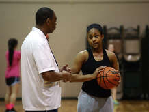 Legacy Christian Coach Jack Gilford talks with Alexis Morris during practice Wednesday afternoon. The Legacy Christian High School basketball team practiced Wednesday afternoon. Photo taken Wednesday 1/21/15 Jake Daniels/The Enterprise