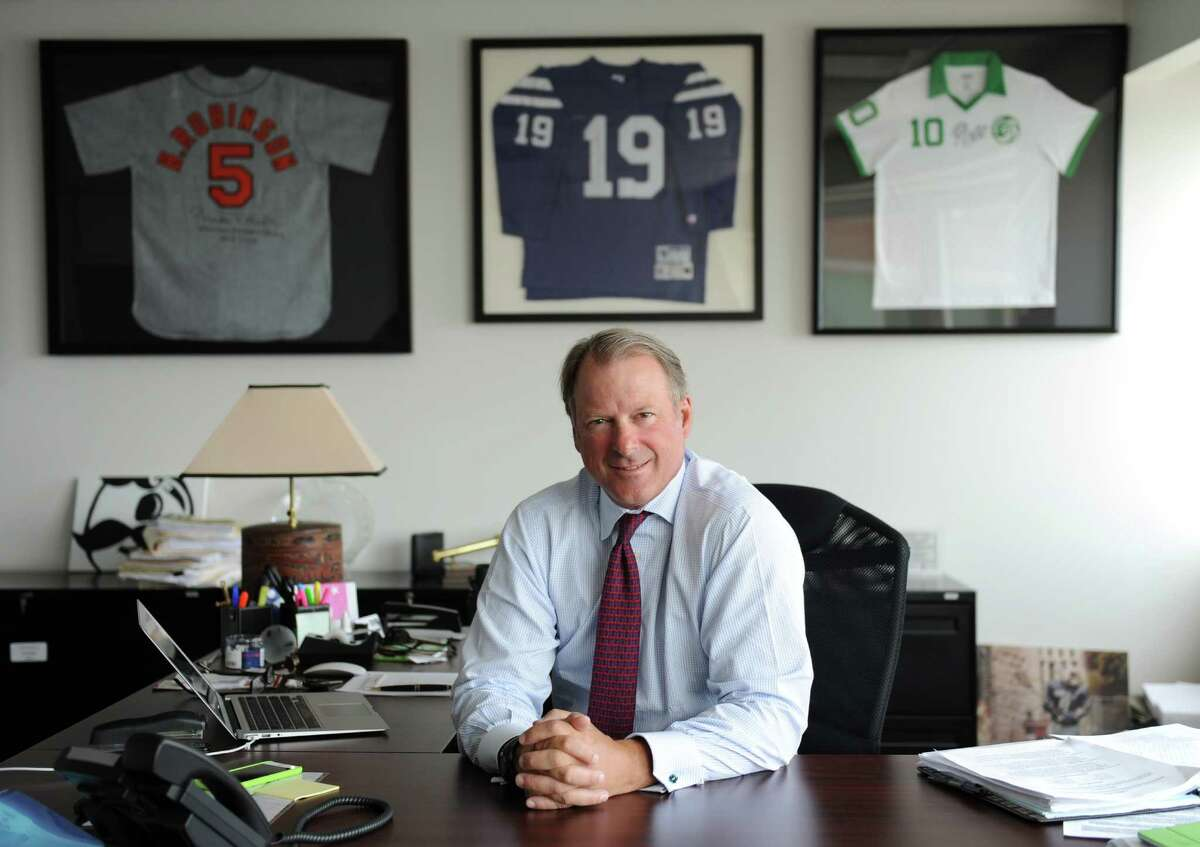 One World Sports CEO Sandy Brown poses at One World Sports headquarters in Stamford, Conn. Tuesday, May 26, 2015. The network will broadcast the New York Cosmos vs. Cuba National Team soccer game in Havana on June 2, marking the first time an American team has played in Cuba in 16 years. It will also be the first live sports production involving a U.S. team to originate out of Cuba since the 2008 U.S. vs. Cuba FIFA World Cup qualifier.