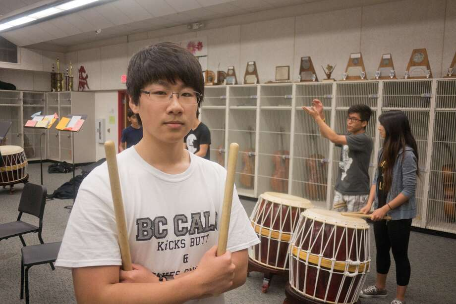 "Memorial High School senior Sehwa ""Nick"" Kang will attend Johns Hopkins University in fall.  Practicing drum with him are ensemble mates Jin Lee, a junior, and Pamela Liou, a senior.    Memorial High School senior Sehwa ""Nick"" Kang will attend Johns Hopkins University in fall.  Practicing drum with him are ensemble mates Jin Lee, a junior, and Pamela Liou, a senior. Photo: R. Clayton McKee, Freelance / © R. Clayton McKee"