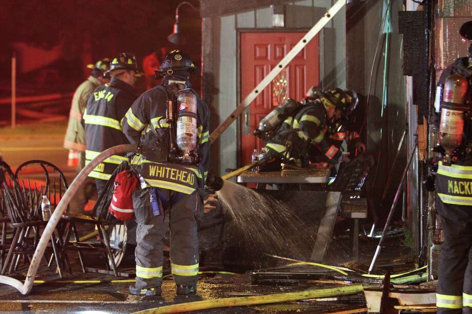 Danbury firefighters work at the scene of a fire that caused considerable damage to O'Brien's Sports Pub & Restaurant on Lake Avenue in Danbury early Monday morning May 25, 2015. The call came in as an automatic alarm and firefighters arrived to find fire in the kitchen and dinning area. Firefighters were able to knock down the main body of fire in about 20 minutes. (Frank Becerra Jr./The Journal News) Photo: Frank Becerra Jr./The Journal Ne, Contributed Photo / The News-Times Contributed