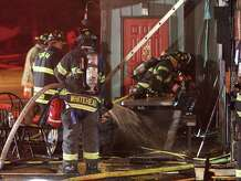 Danbury firefighters work at the scene of a fire that caused considerable damage to O'Brien's Sports Pub & Restaurant on Lake Avenue in Danbury early Monday morning May 25, 2015. The call came in as an automatic alarm and firefighters arrived to find fire in the kitchen and dinning area. Firefighters were able to knock down the main body of fire in about 20 minutes. (Frank Becerra Jr./The Journal News)