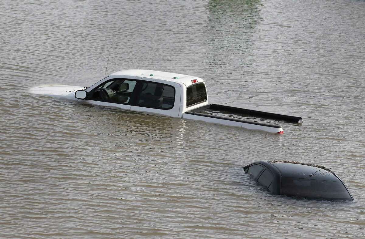 A car and truck are seen flooded in the water on 288 and McGregor in the Medical Center on Tuesday, May 26, 2015 in Houston, TX (Photo: Thomas B. Shea/For the Chronicle)