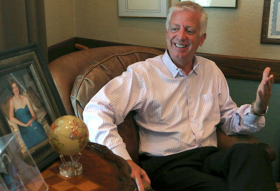 Former homebuilder and philanthropist Gordon Hartman, shown in an interview 2014, plans to add a water park at Morgan's Wonderland, a theme park for children with special needs that opened in 2010. Hartman's daughter, Morgan, is shown in a portrait behind him. Photo: John Davenport /San Antonio Express-News / ©San Antonio Express-News/John Davenport