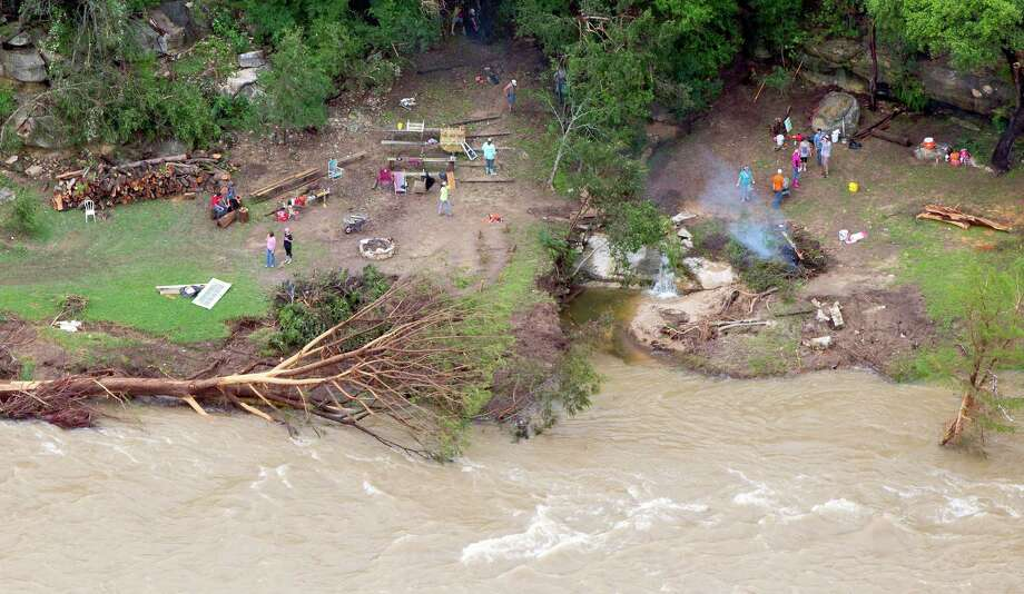 People clean up damage from Memorial Day weekend flooding on the Blanco River in Wimberley as seen in a Tuesday May 26, 2015 aerial picture. Photo: William Luther, San Antonio Express-News / © 2015 San Antonio Express-News