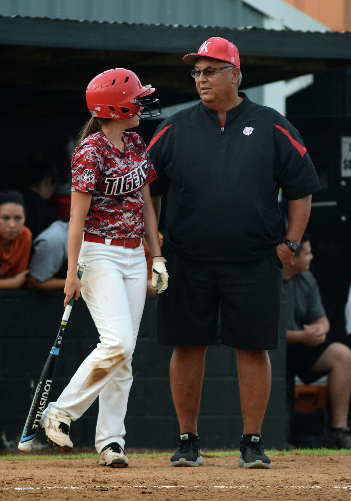 Katy Head Coach Kalum Haack, right, chats with junior shortstop Emily Hitt before her at-bat against Alvin in the top of the 4th inning of game 2 of their Class 6A Regional Semifinal Softball Playoff series at Alvin High School on Friday, May 22, 2015. (Photo by Jerry Baker/Freelance)