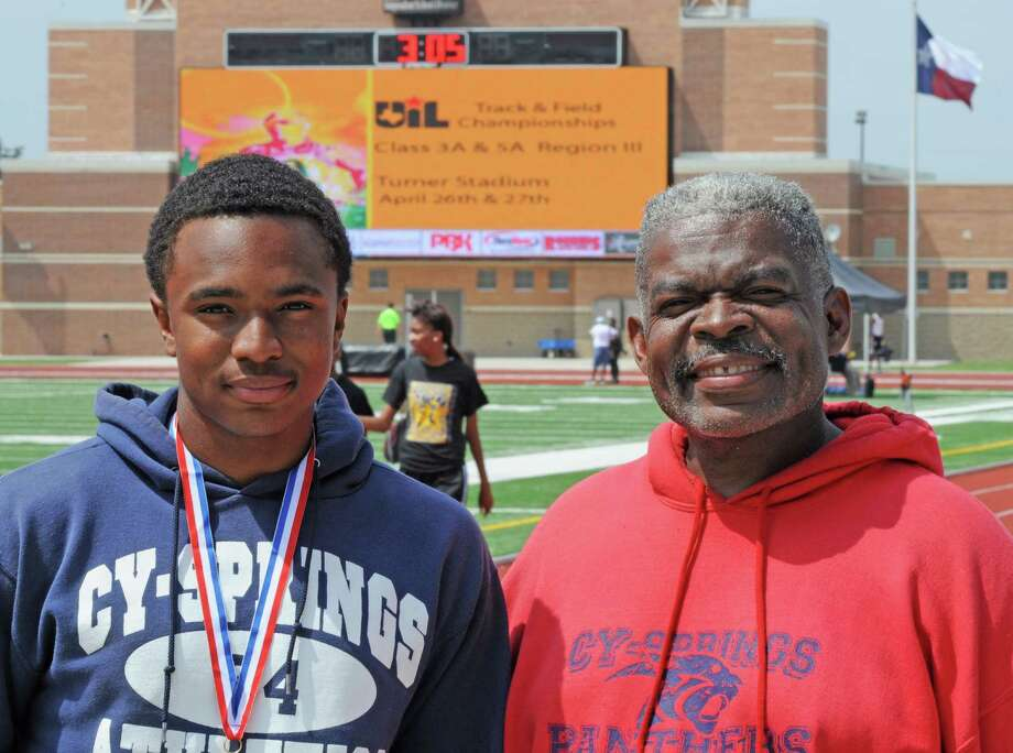 Cy Springs junior and Class 5A Region III gold medalist Isaac Samuels (left) and Cy Springs boys track and field head coach Michael Cahee at regionals on 4-26-13 in Humble. The University Interscholastic League 2013 State Track and Field Championships are May 10-11 in Austin. Photo: L. Scott Hainline / Freelance