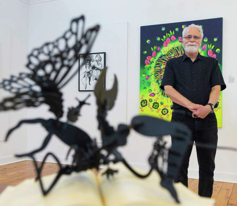 """Guest curator David S. Rubin poses Thursday morning May 21, 2015 among some of the pieces from the ÒNature on the Edge""""  exhibit which features work from more than a dozen San Antonio-based artists who address environmental issues in their work. Photo: William Luther, Staff / San Antonio Express-News / © 2015 San Antonio Express-News"""