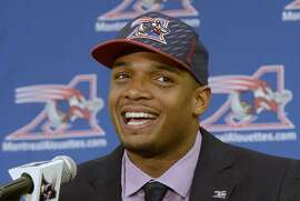 Newly signed Montreal Alouettes defensive end Michael Sam smiles at a press conference in Montreal on Tuesday, May 26, 2015. (Ryan Remiorz/The Canadian Press via AP)