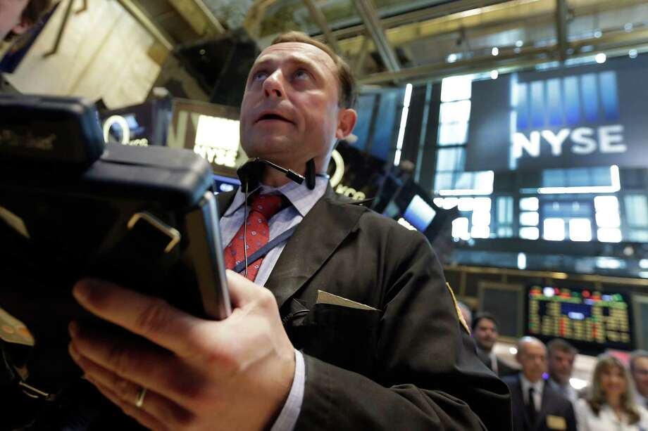 Trader George Baskinger works on the floor of the New York Stock Exchange, Tuesday, May 26, 2015. Stocks are opening lower on Wall Street as traders return from the Memorial Day holiday in the U.S.(AP Photo/Richard Drew) Photo: Richard Drew, STF / AP