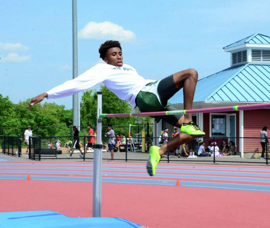 Norwalk High Schools Isiah Gaddy, 18, clears the high jump during the FCIAC Outdoor Field & Track Championships held at Danbury High School on Tuesday, May 26, 2015. Photo: Lisa Weir / The News-Times Freelance