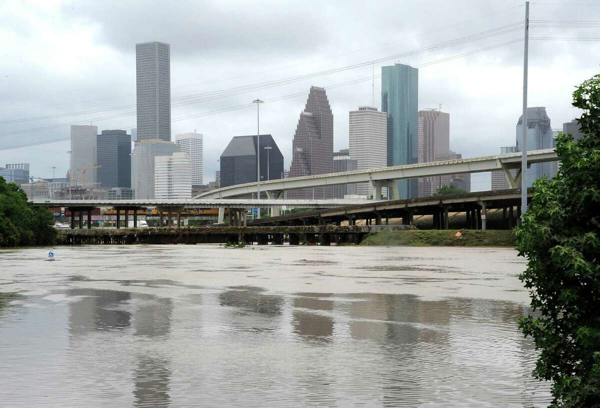 Flood waters overrun the banks of the bayou in downtown Houston in 2015. Allstate hopes to hire 100 new insurance agents in Texas. (AP Photo/Pat Sullivan)