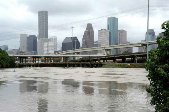 Flood waters overrun the banks of the bayou in downtown Houston, Tuesday, May 26, 2015. (AP Photo/Pat Sullivan)