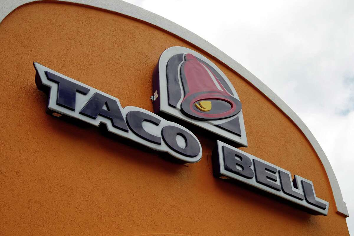 FILE - This Friday, May 23, 2014, file photo shows a sign at a Taco Bell in Mount Lebanon, Pa. Taco Bell and Pizza Hut say they're getting rid of artificial colors and flavors, making them the latest big food companies scrambling to distance themselves from ingredients people might find unappetizing. (AP Photo/Gene J. Puskar, File) ORG XMIT: NY110