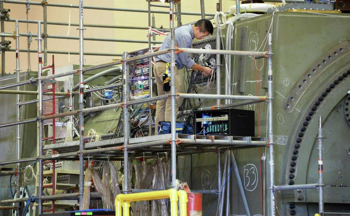 An engineer checks wiring on a NPI hydrogen cooled generator at GE's main plant test facility Tuesday May 26, 2015 in Schenectady, NY. (John Carl D'Annibale / Times Union)