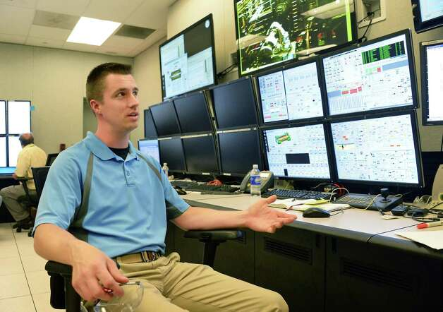 Cell leader Greg Michaelski at the generator final assembly test stand controls at GE's main plant Tuesday May 26, 2015 in Schenectady, NY.  (John Carl D'Annibale / Times Union) Photo: John Carl D'Annibale / 00031999A