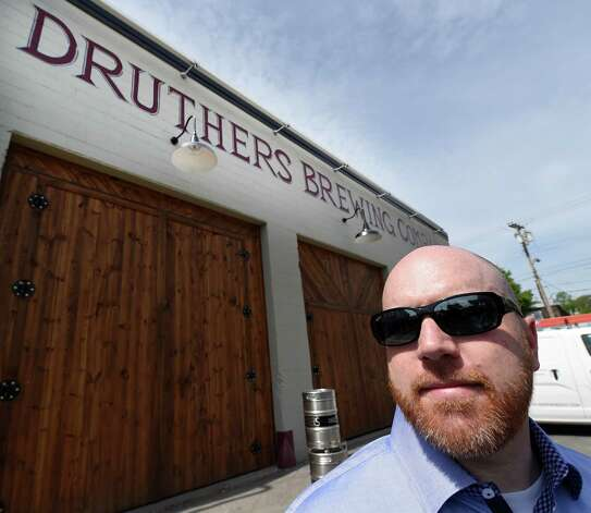 Chris Martell, owner Druthers Brewing Company, is pictured during the opening for Druthers Brewing Company's new establishment on Broadway Tuesday, May 26, 2015, in Albany, N.Y. This their third location in the region. (Skip Dickstein/Times Union) Photo: SKIP DICKSTEIN / 00031991A