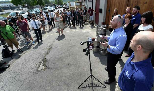 Chris Martell, owner Druthers Brewing Company, speaks during the opening for Druthers Brewing Company's new establishment on Broadway Tuesday, May 26, 2015, in Albany, N.Y. This their third location in the region. (Skip Dickstein/Times Union)) Photo: SKIP DICKSTEIN / 00031991A