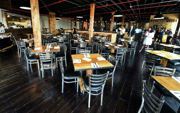 The dining area at the new Druthers Brewing Company which opened Tuesday May 26, 2015, at 1053 Broadway in Albany, N.Y. This is their third location in the region. (Skip Dickstein/Times Union) Photo: SKIP DICKSTEIN / 00031991A