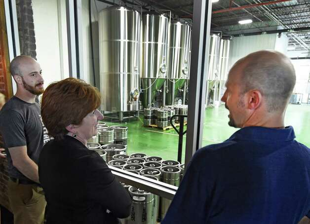 Brewmaster and part owner Geroge DePiro, gives Albany Mayor Kathy Sheehan a tour of the brewing area at the new Druthers Brewing Company which opened today Tuesday May 26, 2015 in Albany, N.Y. at 1053 Broadway. This is Druthers third location in the region.   (Skip Dickstein/Times Union) Photo: SKIP DICKSTEIN / 00031991A
