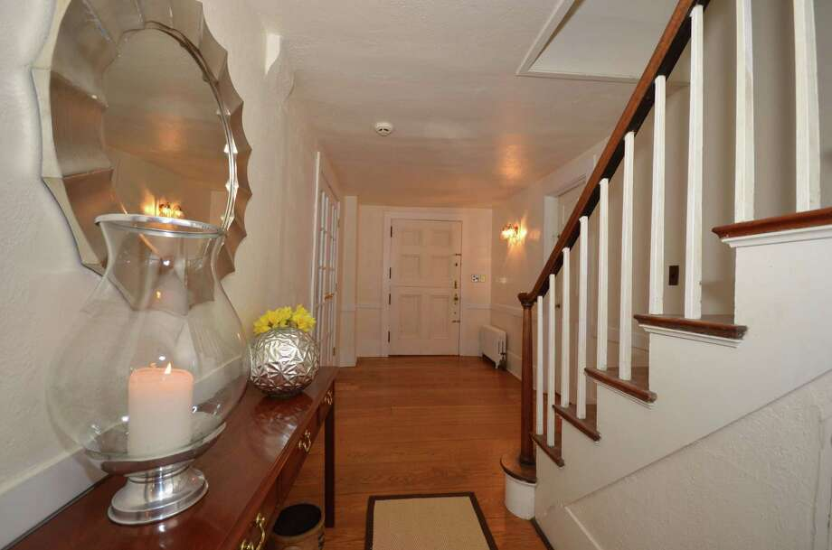 Stairs lead to the second floor, which features four bedrooms, including the master suite. Floor two also includes a laundry room and an office space with built-ins offering additional storage space. Photo: Contributed Photo / New Canaan News