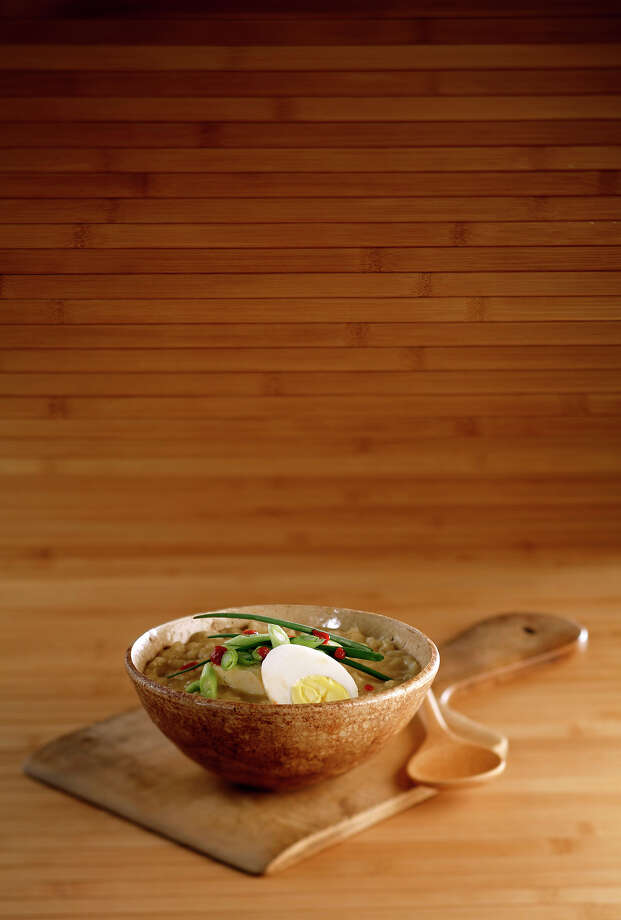 Grated fresh ginger, sauteed mushrooms and hard-cooked are some of the ingredients that can boost your congee. Photo: Michael Tercha /Chicago Tribune / Chicago Tribune