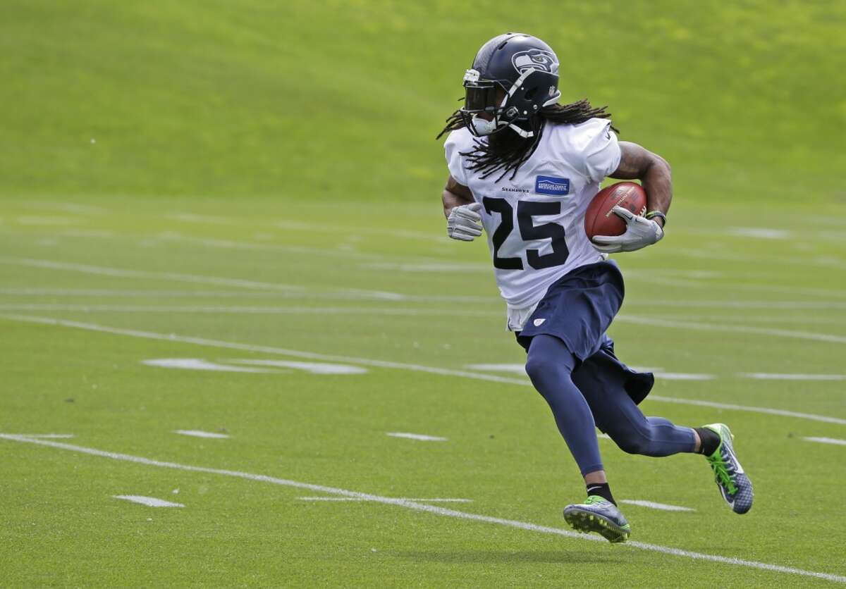Seattle Seahawks cornerback Richard Sherman runs with the ball during an organized team activity Tuesday, May 26, 2015, in Renton, Wash. (AP Photo/Ted S. Warren)