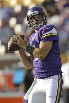 Minnesota Vikings Christian Ponder runs through some drills before the game against the Oakland Raiders, Friday, Aug. 8, 2014 in Minneapolis. (Mike McGinnis/AP Images for Panini)