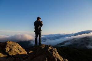 The East Peak of Mount Tamalpais provides a great spot to watch the fog roll in over the Bay Area in Mill Valley, Calif., Tuesday May 19, 2015.