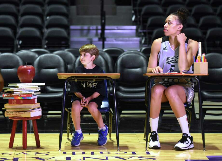 Stars rookie Dearica Hamby sits with Luke Tucker as they prepare to shoot a promotional video during media day at Freeman Coliseum. The Stars begin the regular season June 5 at Phoenix and open their home schedule June 14 against Tulsa. Photo: Billy Calzada / San Antonio Express-News / San Antonio Express-News