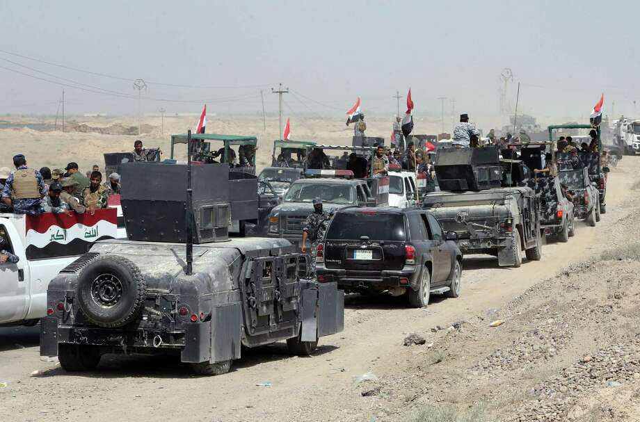 Iraqi security forces and paramilitar- ies deploy northwest of Baghdad in an effort aimed at cutting off Islamic State militants in Anbar province before a major offensive to retake the city of Ramadi. Photo: Ahmad Al-Rubaye /Getty Images / AFP