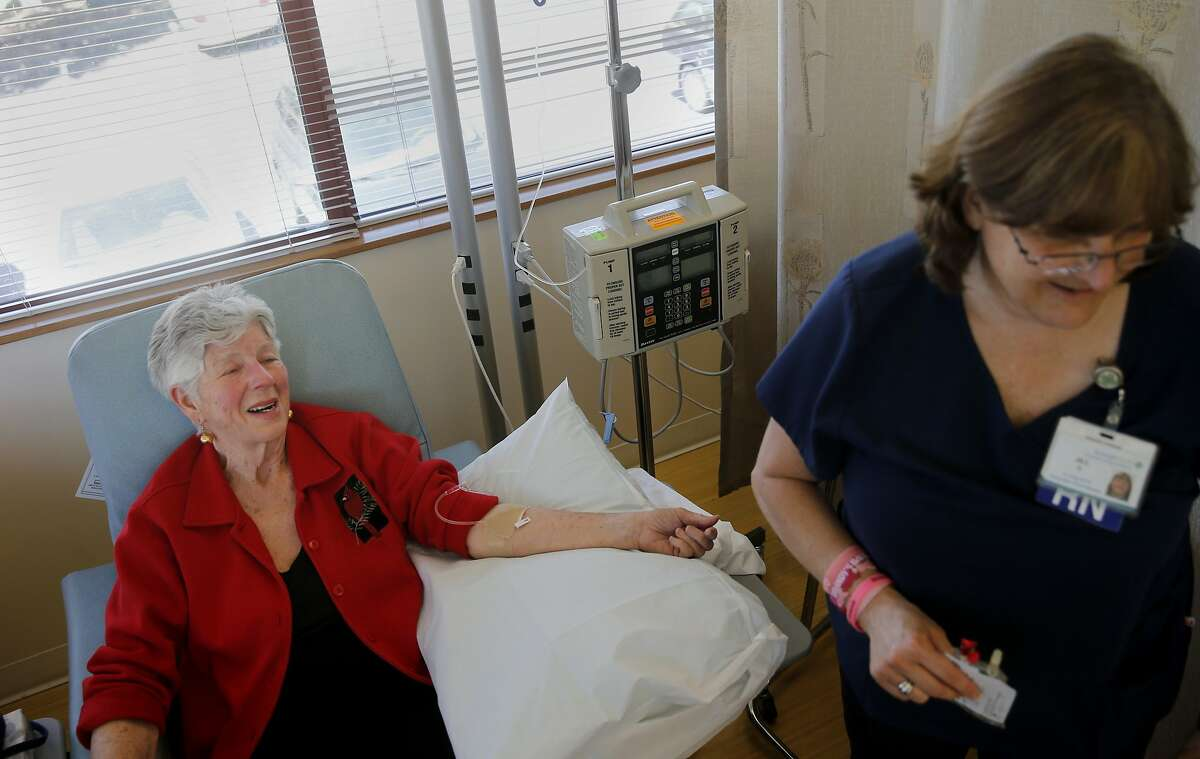 Carolyn McLeese enjoys a light moment with a nurse as she finishes her infusion Tuesday May 26, 2015. Carolyn McLeese is an Alzheimer's patient involved in the new clinical trial of new alzheimer's drugs which have showed some solid early-phase results. She is receiving an infusion at a St. Joseph Health facility in Santa Rosa, Calif.