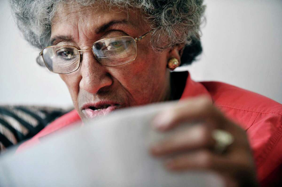 Barbara Noisette-Jackson looks through some paper work detailing her younger years as she talks about her life during an interview at her home on Tuesday, May 26, 2015, in Albany, N.Y. (Paul Buckowski / Times Union)