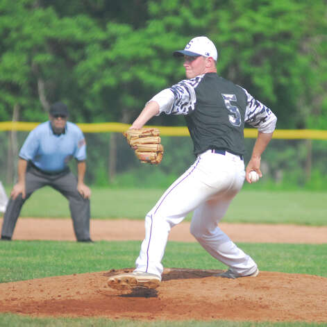 Staples sophomore Ben Casparius throws a pitch during a game against Warde on Tuesday in the FCIAC baseball quarterfinals. Staples won 3-0 as Casparius fired a one-hitter. Photo: Ryan Lacey/Staff Photo / Westport News Contributed