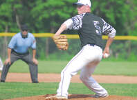 Staples sophomore Ben Casparius throws a pitch during a game against Warde on Tuesday in the FCIAC baseball quarterfinals. Staples won 3-0 as Casparius fired a one-hitter.