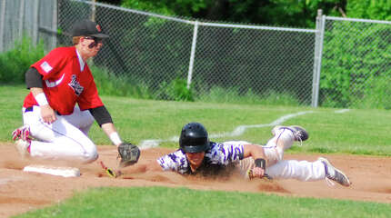 Warde third baseman Zach Weinstein, left, tags Staples' Michael Cusa in a game on Tuesday.