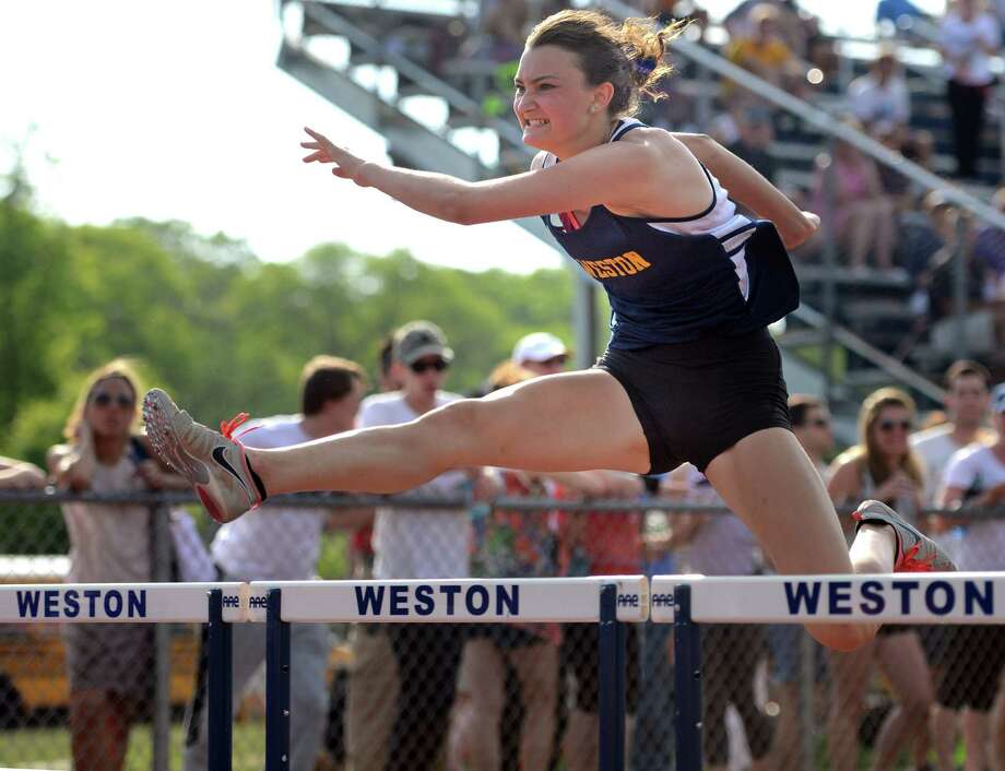 Weston's Nathalie Feingold competes in the 110 meter hurdles during the 2015 SWC Outdoor Track and Field Championship Meet Tuesday, May 26, 2015 at Weston High School. Photo: Autumn Driscoll / Connecticut Post