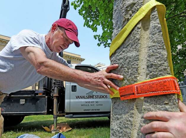 "Sculptor John Van Alstine is hands on at the Albany Institute of History & Art as he installs his sculpture ""Working the Sails"" (1990) in the Weir Sculpture Garden Tuesday afternoon, May 26, 2015, in Albany, N.Y. The sculpture is a bequest from the Estate of Philip M. Smith and it pays homage to the sailing vessels that have plied the Hudson River for centuries.   (Skip Dickstein/Times Union) Photo: SKIP DICKSTEIN / 00032005A"