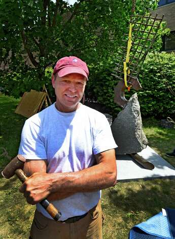 Sculptor John Van Alstine, poses with his artwork at the Albany Institute of History & Art after he installed his sculpture Working the Sails (1990) in the Weir Sculpture Garden Tuesday afternoon May 26, 2015 in Albany, N.Y.  The sculpture is a bequest from the Estate of Philip M. Smith and it pays homage to the sailing vessels that have plied the Hudson River for centuries.   (Skip Dickstein/Times Union) Photo: SKIP DICKSTEIN / 00032005A