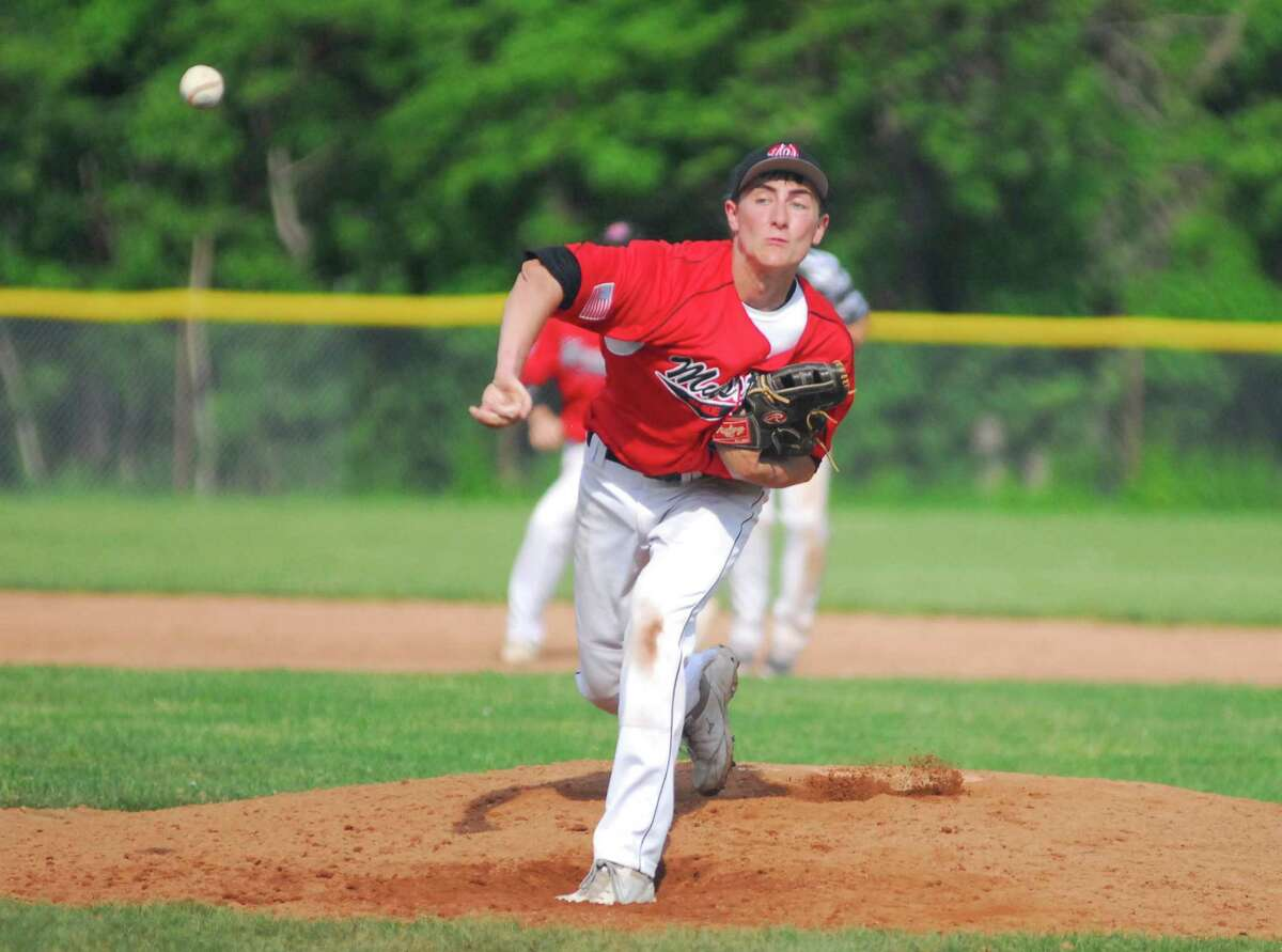 Warde pitcher John Natoli throws a pitch during a game against Staples on Tuesday.