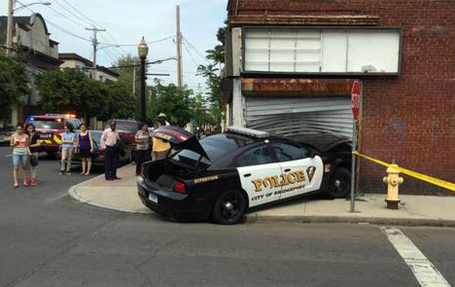 A police cruiser slammed into a building in Bridgeport's East End on Tuesday May 26, 2015, injuring one officer. Photo: Fausto Giovanny Pinto / Connecticut Post