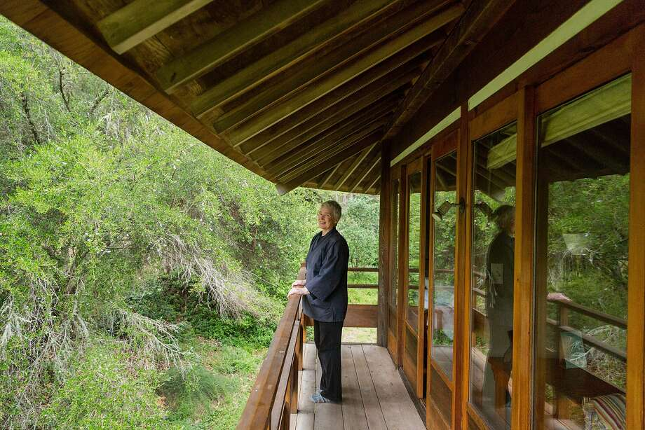 Shokuchi Deirdre Carrigan, a guest program manager at Green Gulch, stands on a balcony of the Lindesfarne Guest House. Photo: Jason Henry, Jason Henry For Medium
