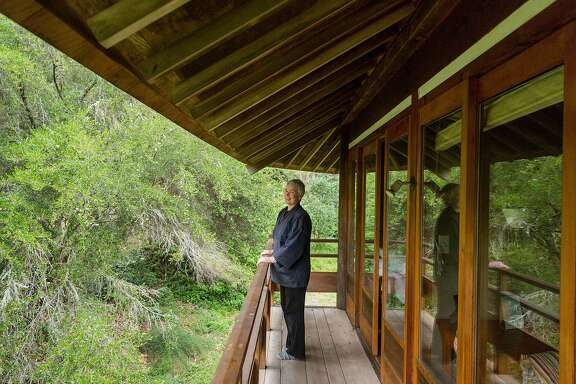 Shokuchi, a guest program manager, on a balcony overlooking the landscape in the octagonal Lindisfarme style guest house at Green Gulch Farm and Zen Center in Muir Beach, Calif., Friday, May 22, 2015.