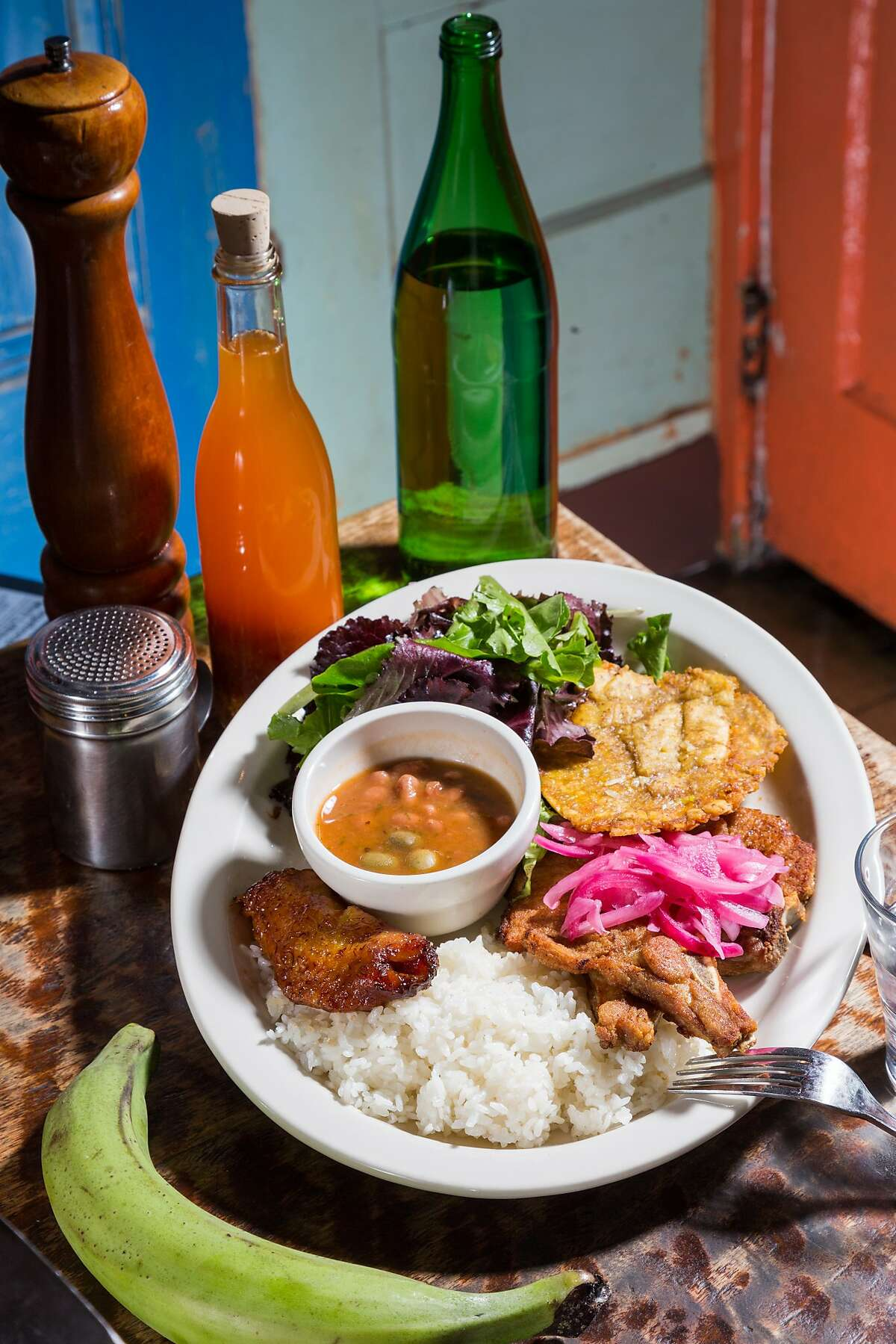 Puerto Rican food. If Marin's hugely popular Sol Food could open an S.F. outpost that would fulfill the need. Pictured: A plate of fried pork, plantains, tostones, rice and beans, and salad at Sol Food in San Rafael.